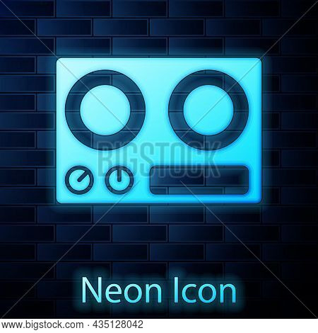 Glowing Neon Gas Stove Icon Isolated On Brick Wall Background. Cooktop Sign. Hob With Four Circle Bu