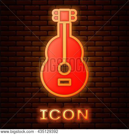 Glowing Neon Spanish Guitar Icon Isolated On Brick Wall Background. Acoustic Guitar. String Musical