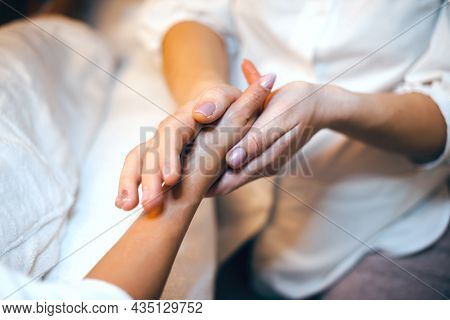 Beautiful Closeup Photo Of Palm And Hand During Spa Massage. Young Woman Skin Care. Beautiful Female
