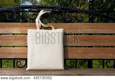 Rustic Tote Bag On The Outdoor Bench Mockup