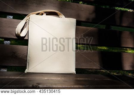 Canvas Tote Bag In The Sunlight On The Bench Mockup