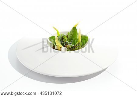 Healthy vegetarian green salad. Veggie organic food - avocado, broccoli, green leaf, tomato. Plant based dining. Meatless menu. Fresh salad with green vegetables isolated on white background