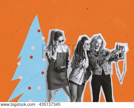 Three Young Girls In Retro 90s Fashion Style, Outfits Posing Isolated Over Orange Background. Concep