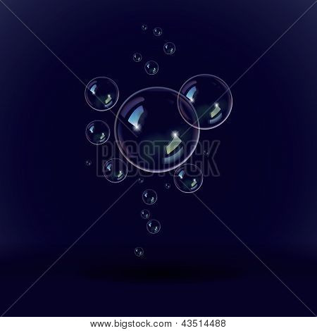 Soap bubbles on a black and blue background