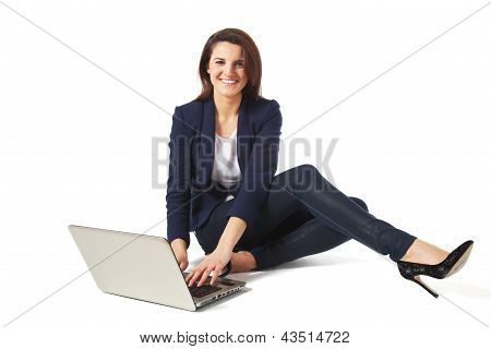 Portrait Of A Beautiful Young Businesswoman Using Laptop