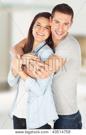 Cheerful Young Couple Standing At Home