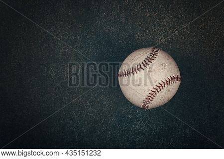 Close Up One Old Worn Vintage Baseball Ball With Red Stitch On Grunge Dark Brown Background With Cop