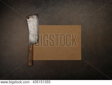 Close Up One Vintage Butcher Meat Cleaver And Brown Paper On Cutting Board Or Grunge Brown Table Sur