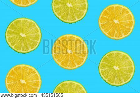 Seamless Pattern Of Fresh Ripe Orange And Lime Round Cut Wedges On Vivid Blue Background