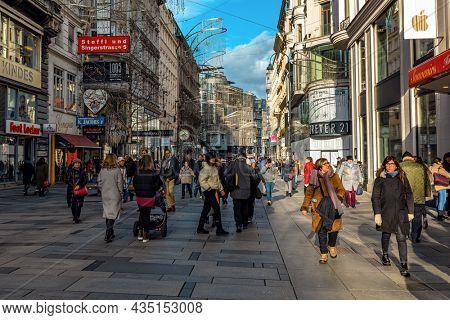 VIENNA, AUSTRIA - DECEMBER 03, 2019: People walking on Karntner strabe - most famous shopping street in central Vienna.