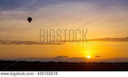 Balloon ride over the Masai Mara at sunrise. Popular tourist activity to get an aerial view of the wildlife and savannah.