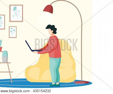 Businessman Or Freelancer, Student Standing At Home With Laptop. Working From Home Office. Young Man