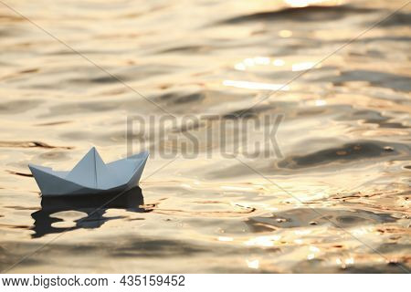 Paper Boat Floating On Water Outdoors. Space For Text
