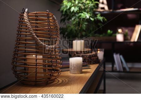 Burning Scented Candles On Wooden Console Table In Room. Space For Text