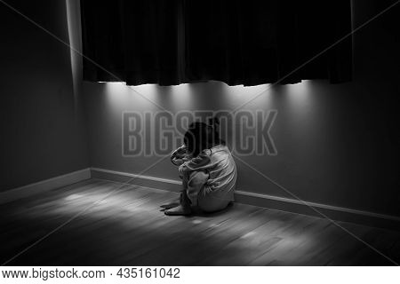 Squat Single Child Sit Near Window, Sad Lonely In Dark Night Indoor, Crying, Bad Mood, Offended, Con