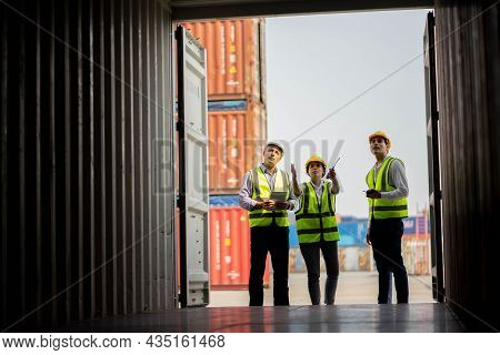 Team Engineer Dock Control Logistics Worker Wear Safety Helmets And Protect Suite Open Cargo Contain
