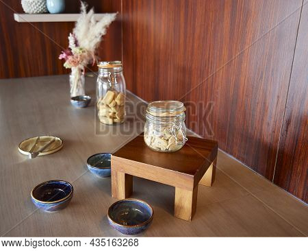 Glass Jar With Toasts. Placed On A Sideboard With Other Objects
