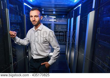 Bearded Handsome Maintenance Administrator Working With Tech It Equipments In Data Center