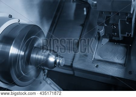The  Cnc Lathe Machine Forming  Cutting The Metal Shaft Parts. The Hi-technology Metal Working Proce