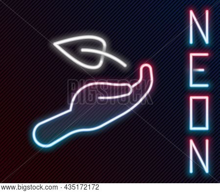 Glowing Neon Line Sprout In Hand Of Environmental Protection Icon Isolated On Black Background. Seed