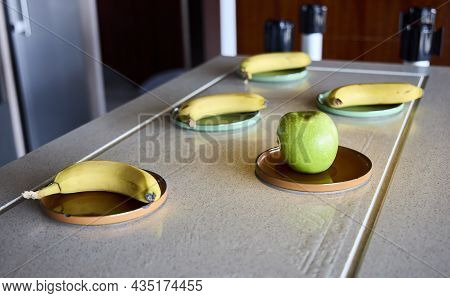 Apple In A Clay Plate. It Is On A Sideboard With More Fruits.