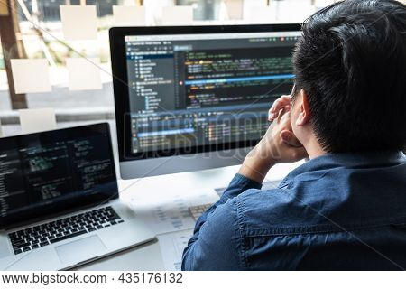 Developer Programmer Working On Project In Software Development Computer In It Company Office, Writi