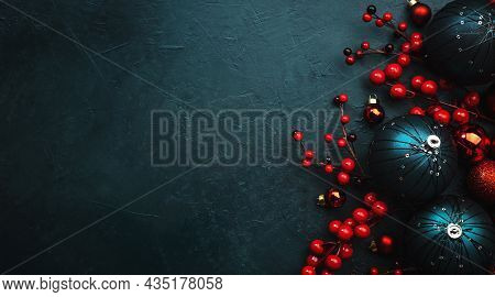 Blue Christmas Or New Year Banner Background With Blue Christmas Balls, Red Berries, Top View, Place