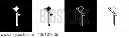 Set Crutch Or Crutches Icon Isolated On Black And White Background. Equipment For Rehabilitation Of
