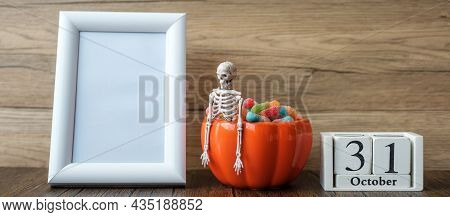 Pumpkin Bowl Of Candy, 31 October Calendar And Frame With Copy Space For Text. Happy Halloween Day,