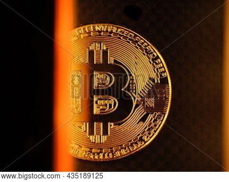 Bitcoin golden digital coin money closeup on dark background