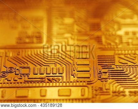 Digital currency bitcoin coin golden computer circuit board background, closeup