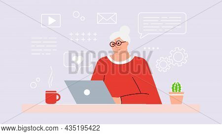 Senior Woman Studies And Studies Modern Technologies Using A Laptop. A Positive Smiling Grandmother