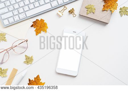 Cozy Home Office Desk Table. Workspace With Smartphone Mockup, Keyboard, Glasses, Paper Notebook, Ma