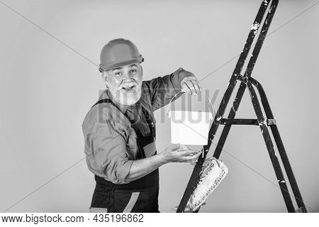 Building Is His Life. Craftsman With Paint Roller. House Painting And Renovation Business. Making Re