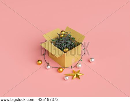 Cardboard Box Filled With Tangled Christmas Lights And Ornament Balls. Christmas Decoration Concept.