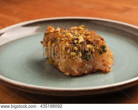 Syrian Semolina Cake With Sugar Syrup, Tasty Harisse On A Blue Ceramic Plate, Syrian Dessert