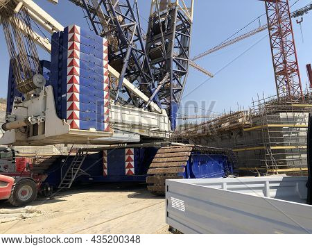 Trucks And Counterweight Of Crawler Crane At Construction Site.