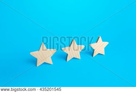 Three Stars On A Blue Background. Rating Evaluation Concept. Service Quality. Buyer Feedback. High S