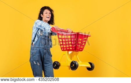 Happy Woman Carry Shopping Cart. Shopper Girl Have Fun. Marketing Concept. Female Housewife With Sho