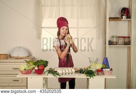 Cook Delicious Recipe. Chef Girl In Hat And Apron. Kid Cooking Food In Kitchen. Choosing A Career. L