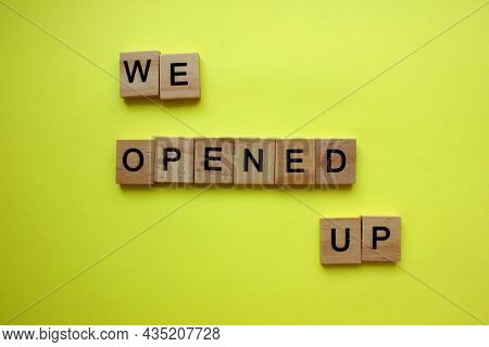 The Word, We Opened Up, Is Made Of Wooden Blocks On A Yellow Background. Informing Plate. Announceme