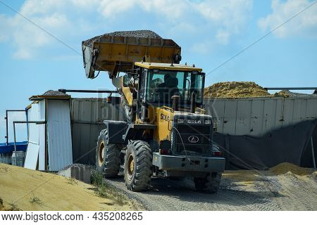 The Work Of A Loader Loading Crushed Stone. Voronezh Region. Russia. July 2021