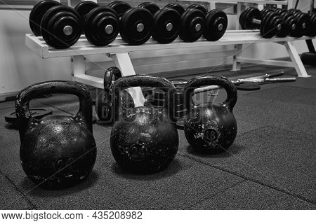 Bodybuilding Equipment. Kettlebells On Rubber Floor In The Gym. Fitness Or Bodybuilding Concept Back