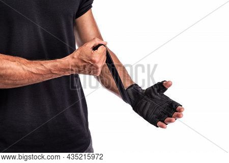 Fitness Man In Training Put Fitness Gloves In White Background, Fitness Concept, Sport Concept. Clos