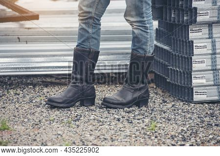 Women Wear Construction Boots Safety Footwear For Worker At Construction Site. Woman Engineer Wear J