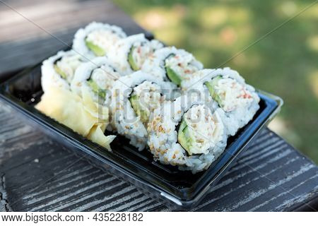 California Rolls Maki Sushi Japanese Food On Picnic Table Outdoor