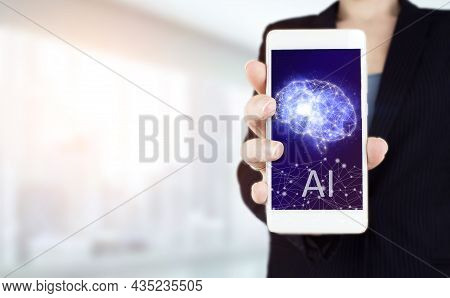 The Modern Concept Of The Cyberbrain. Hand Hold White Smartphone With Digital Hologram Artificial Br