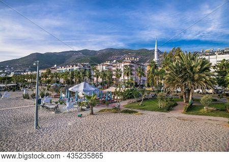 Alanya , Turkey- October 20, 2020:  Beautiful sunset at Cleopatra Beach, popular among tourists for recreation. Alanya, Antalya district, Turkey, Asia