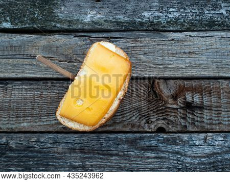 Hard Cheese Sandwich And A Cup Of Coffee On A Wooden Table. Hard Cheese. Butter. White Bread. Cardbo