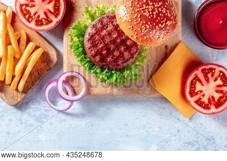 Burger Ingredients On A Wooden Board, Overhead Flat Lay Shot With A Place For Text. Hamburger And Fr